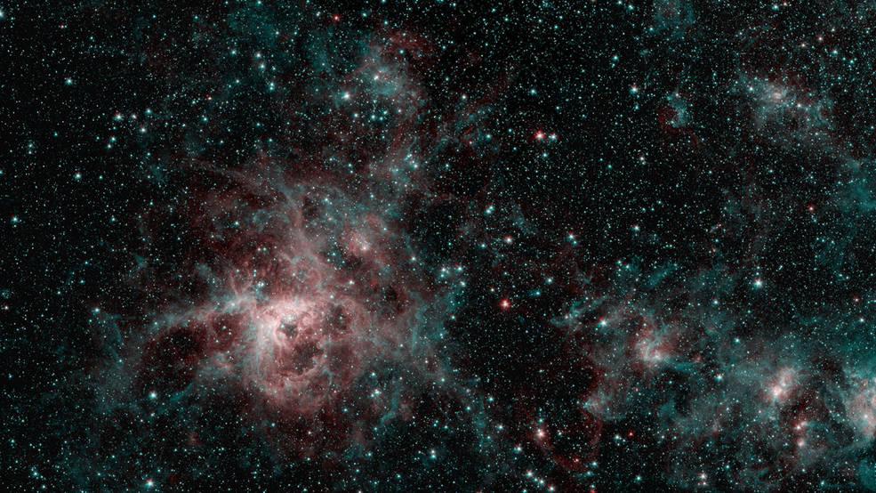 La Nebulosa de la Tarántula hace girar la red del misterio en una imagen de Spitzer.
