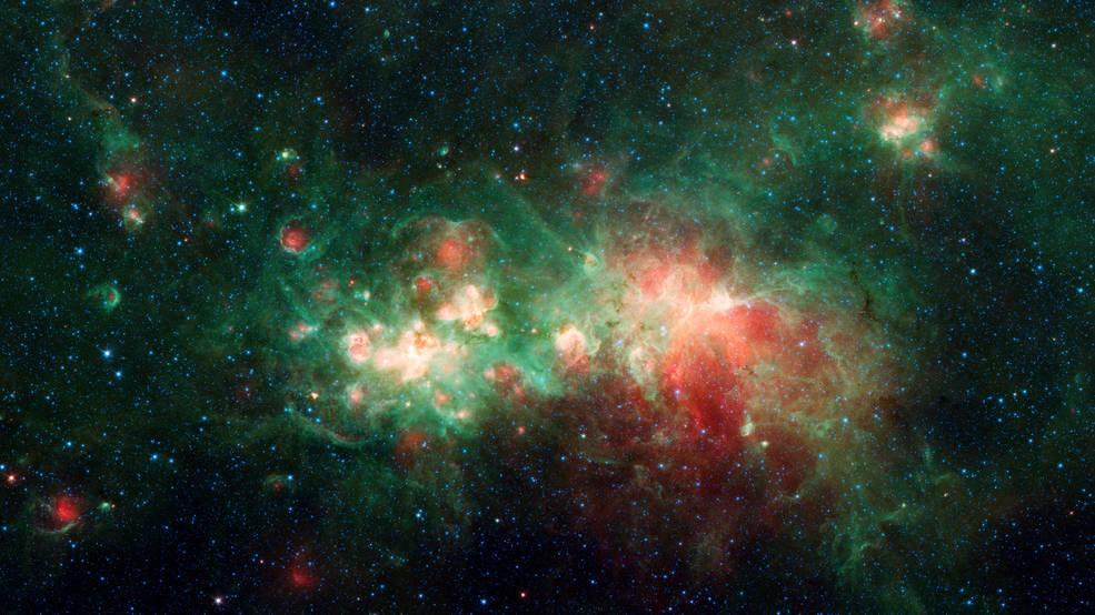 """¿Dónde se hacen las estrellas? El telescopio espacial Spitzer de la NASA """"espía"""" un punto caliente."""