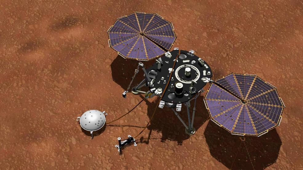 Ingenieros de la NASA revisan los sensores meteorológicos de la misión InSight.